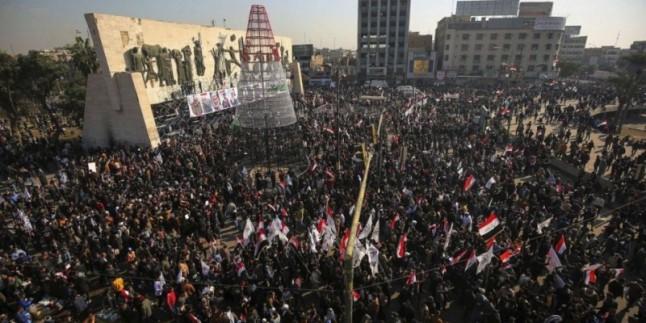 Irak halkı, direniş cephesinin şehit komutanlarıyla biat tazeledi