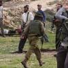 Siyonist Yerleşimciler İşgal Askerlerinin Himayesinde Filistin Köyüne Saldırdı