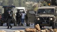İşgal Güçleri Batı Yaka ve Kudüs'te 18 Filistinliyi Gözaltına Aldı