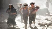 Büyük Şeytan Amerikaya Bağlı Uçaklar Rakka Şehrindeki Sivilleri Vahşice Bombaladı. 15 Şehid