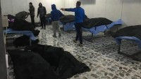 Katil Amerika İHA'larının Saldırısında Şehid Düşen General Kasım Süleymani, Ebu Muhendis Ve Diğer 5 Şehid'in Cenazeleri Morga Taşındı