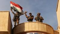 Kerkük'te kamu binalarında yeniden Irak bayrağı göndere çekildi
