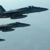 Büyük Şeytan ABD Koalisyonunun Suriye ve Irak'ta düzenledikleri hava saldırılarında en az 855 sivil hayatını kaybetti