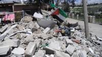 Siyonist İsrail Filistinlilerin binalarını yıktı